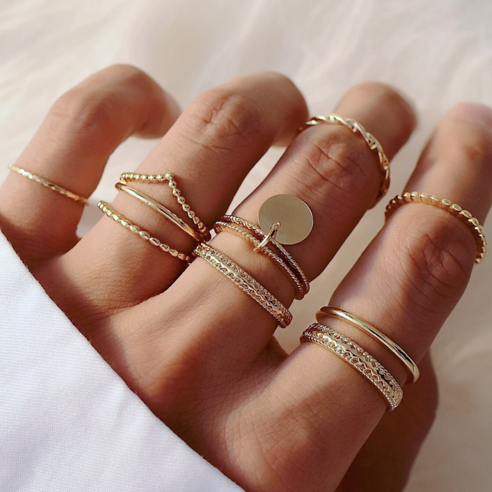thin gold rings with circles and medals