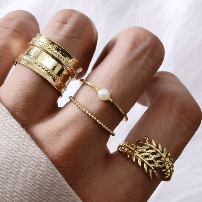 thin and wide metallic gold leaf shaped rings