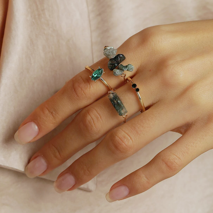 golden rings with blue, green and turquoise rhinestones