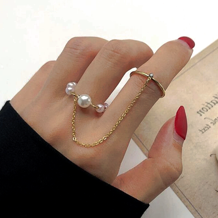 golden rings with chain and white pearls