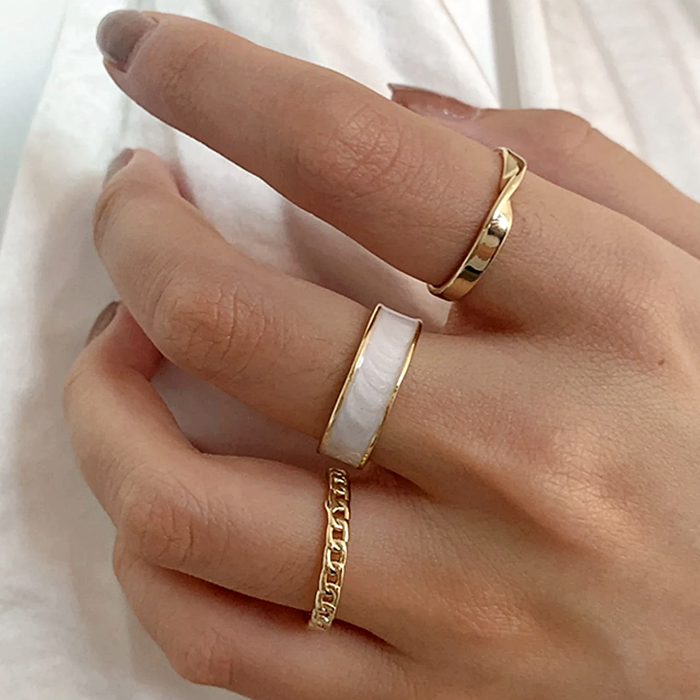 thin gold rings with white
