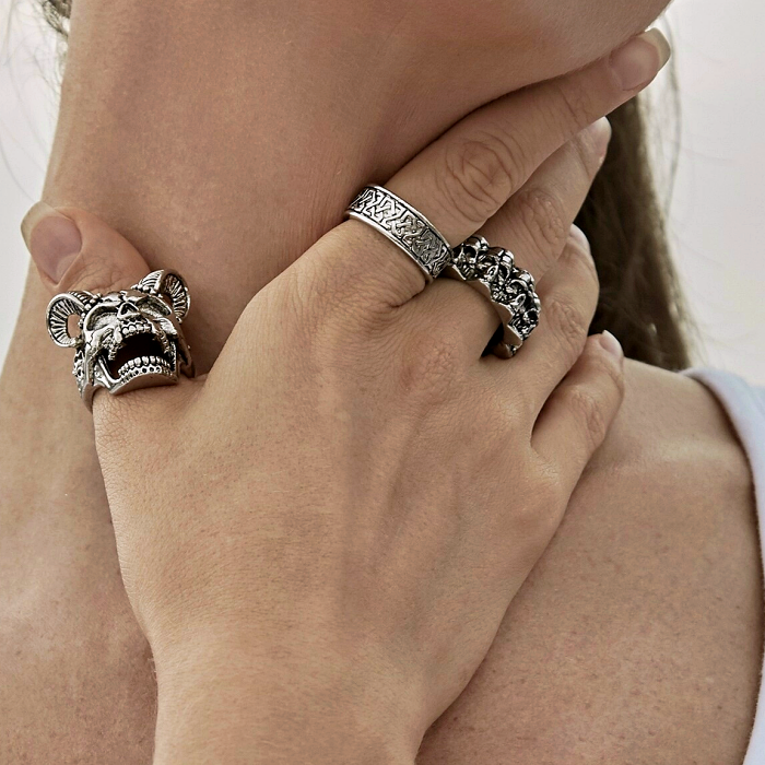 chunky metallic silver rings with skull, chains and square