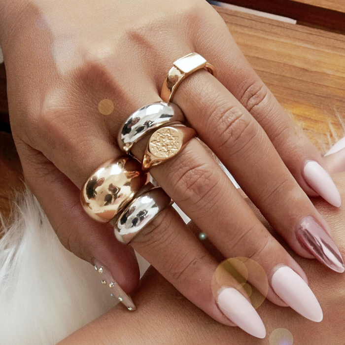 chunky silver and gold rings with smooth, rounded design, signet style
