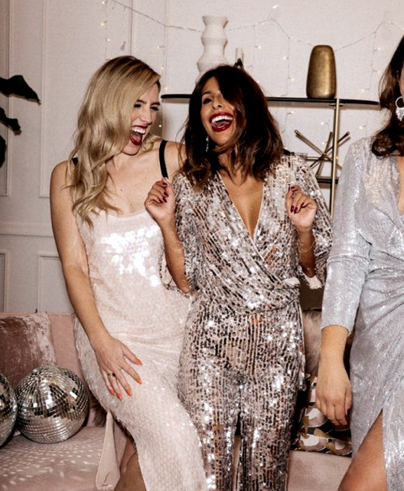 blonde girl and brown haired girl wearing metallic silver dress with V neckline, metallic white strap dress