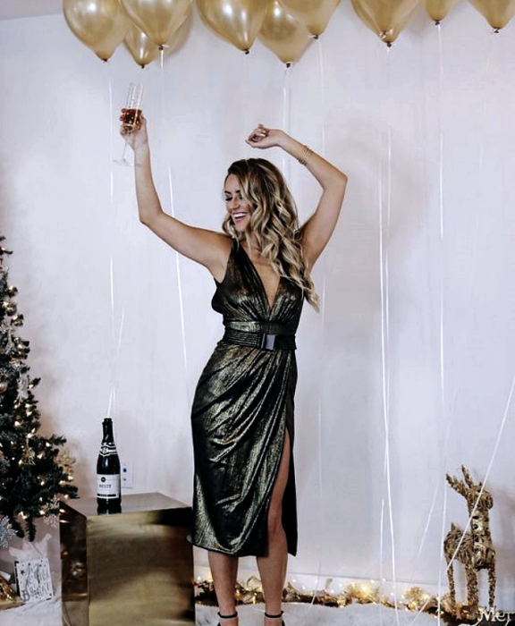 blonde girl wearing metallic copper dress with short sleeves, V-neckline and leg opening