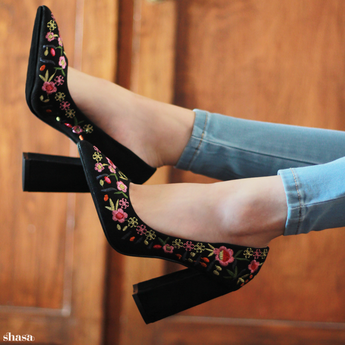 girl in high black sneakers embroidered with colorful flowers; 13 embroidered shoes that you would like to have in your wardrobe