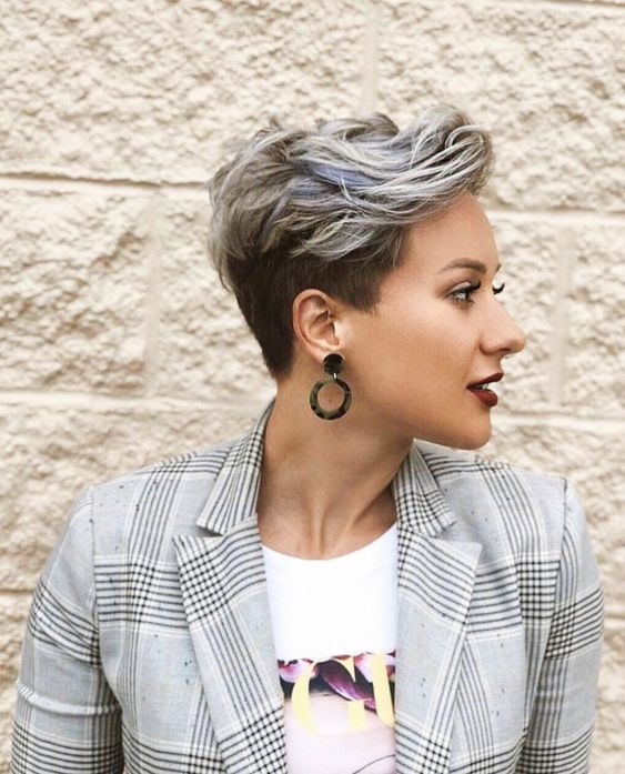 Girl looking to the side with platinum pixie style hair
