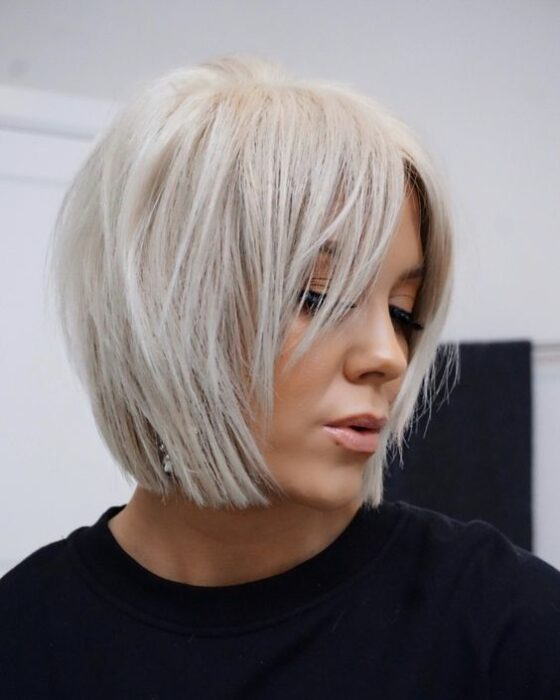 Platinum-haired blonde woman in very short haircut