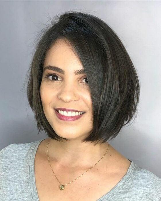 Light brunette woman with short hair