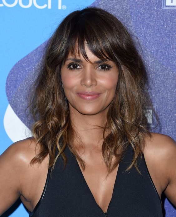 Halle Berry with layered medium hair with side long fringe