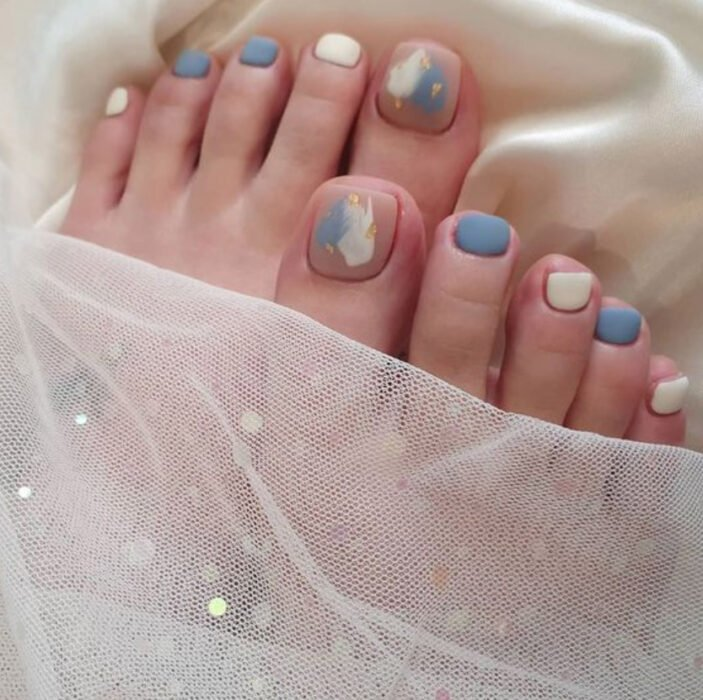 Pedicure in white and sky blue colors