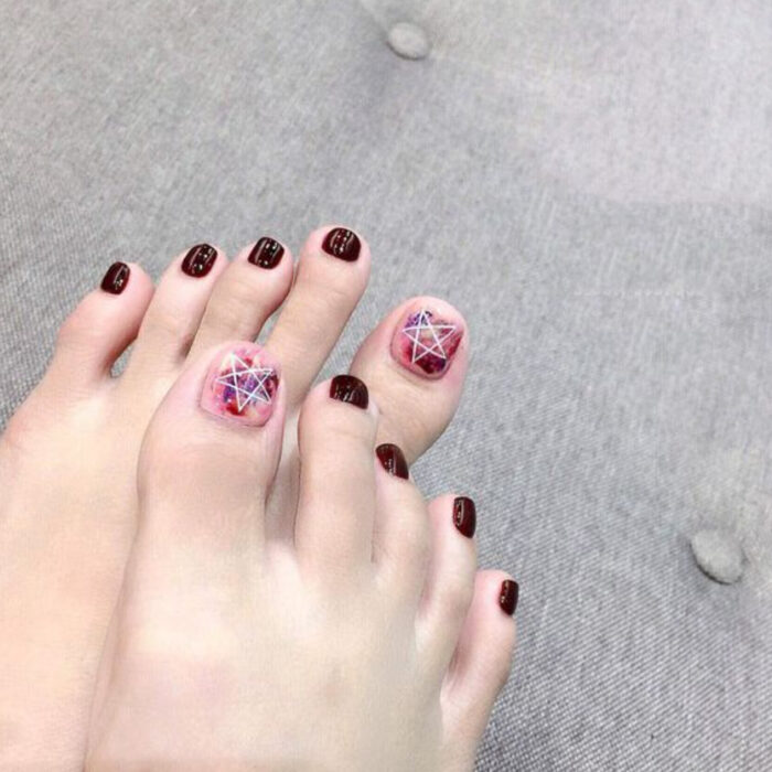 Pedicure in cherry and pink colors