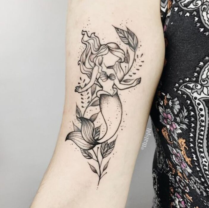 Tattoo inspired by the movie 'The Little Mermaid' in the forearm area