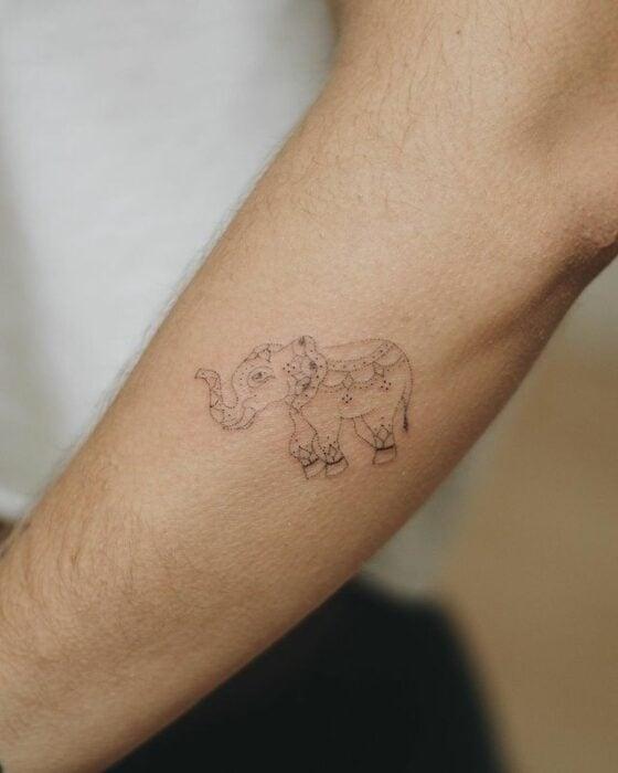 Elephant arm tattoo
