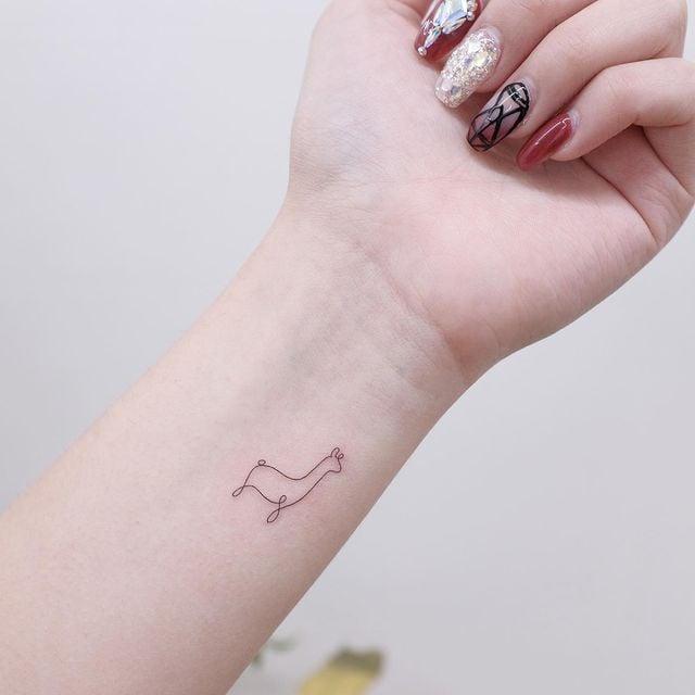 Llama tattoo on arm