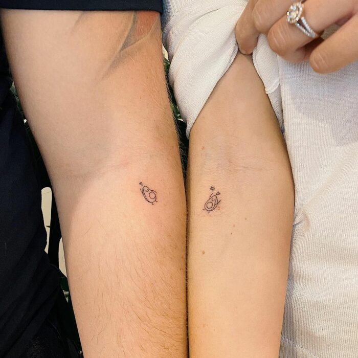 Avocado tattoo on arm for couples