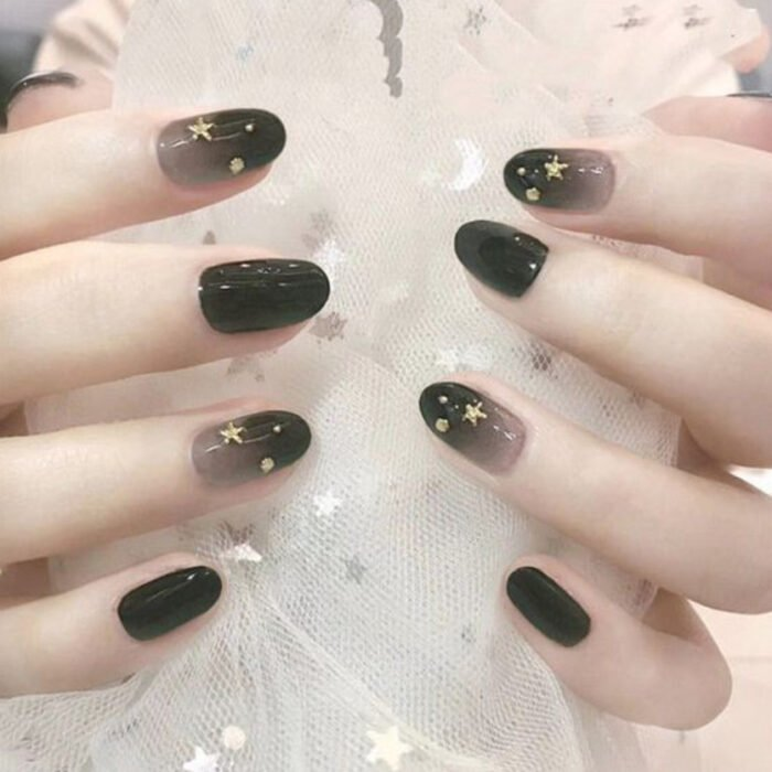Stylish gradient manicure in black and white colors