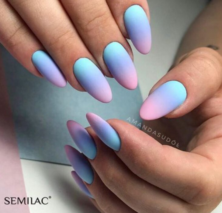 Stylish gradient manicure in blue, purple and pink colors