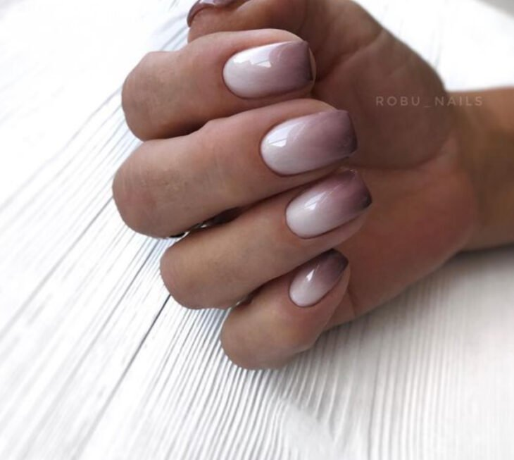 Stylish gradient manicure in coffee and nude colors