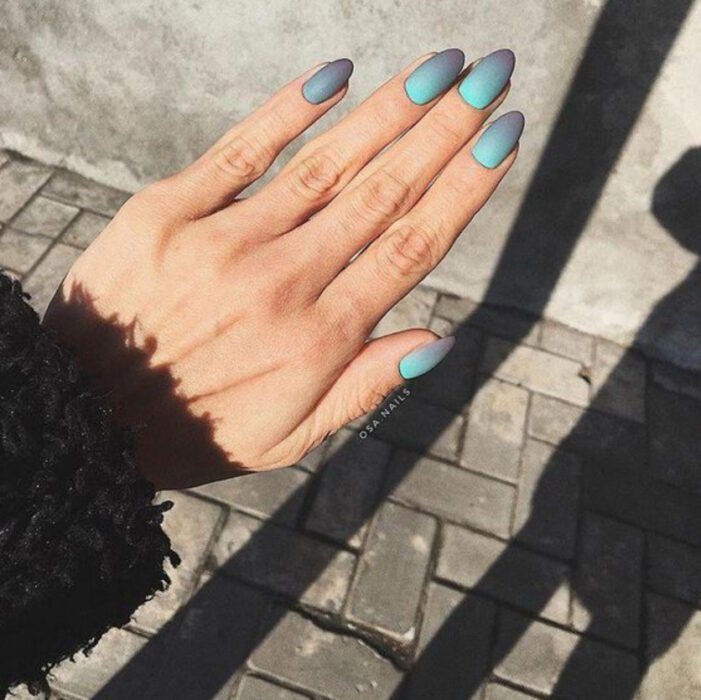 Stylish gradient manicure in blue and gray colors