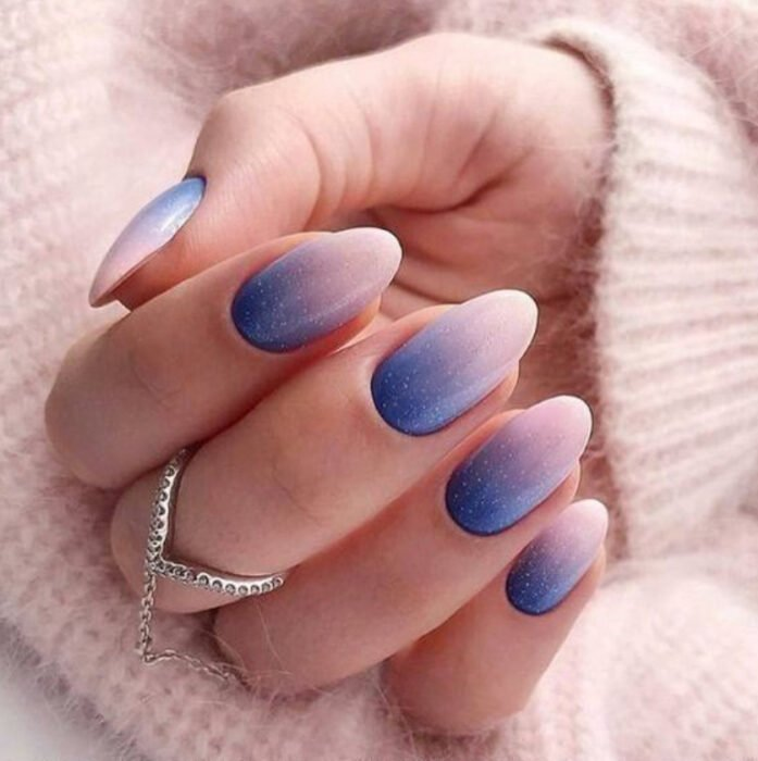 Stylish gradient manicure in blue and nude colors