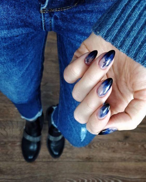Stylish gradient manicure in navy blue and white colors