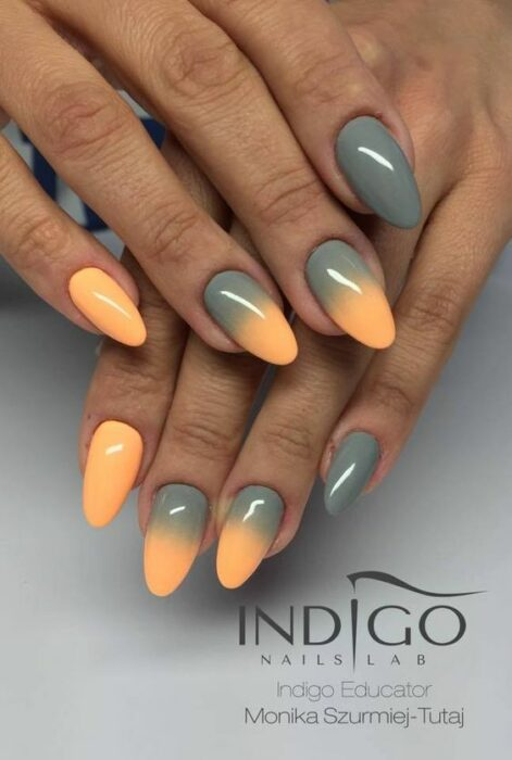 Stylish gradient manicure in orange and olive green colors
