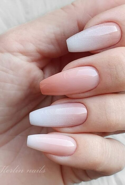 Stylish gradient manicure in white and coral colors