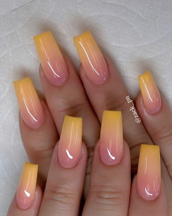 Stylish gradient manicure in yellow and coral colors