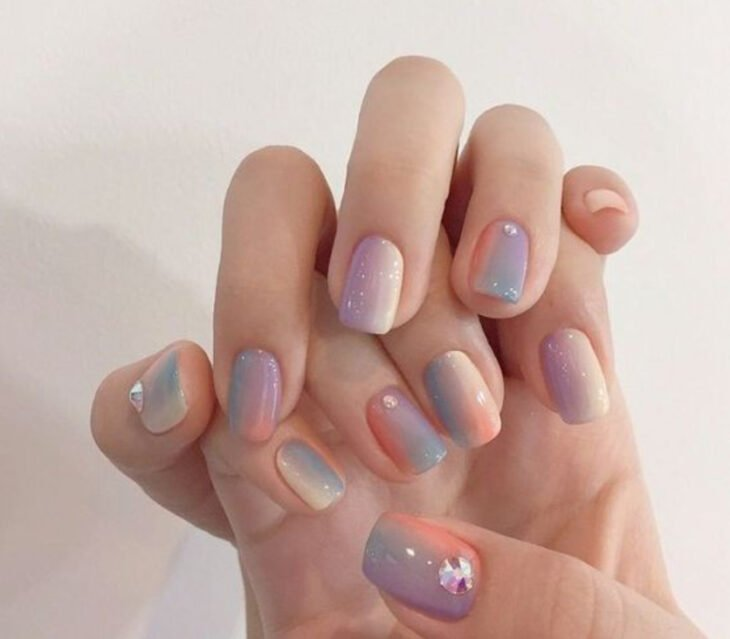 Stylish gradient manicure in rainbow colors