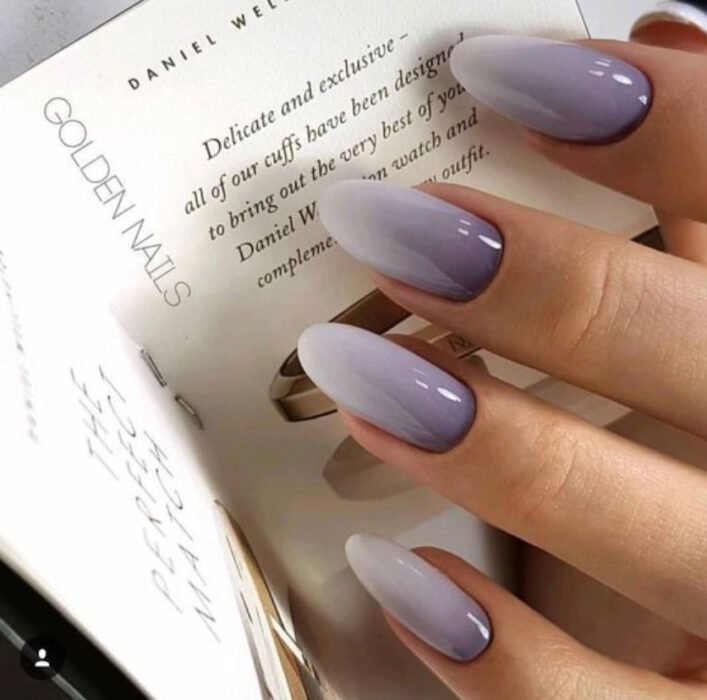 Stylish gradient manicure in lilac and gray colors
