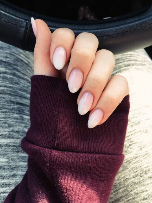 Girl with stiletto manicure in white with natural effect