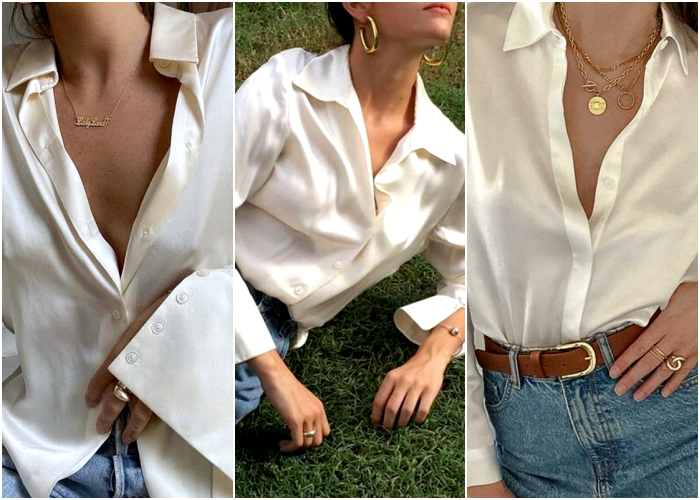 girl in white silk dress shirt with gold jewelry chunky necklaces long hoop earrings gold signet rings and blue jeans