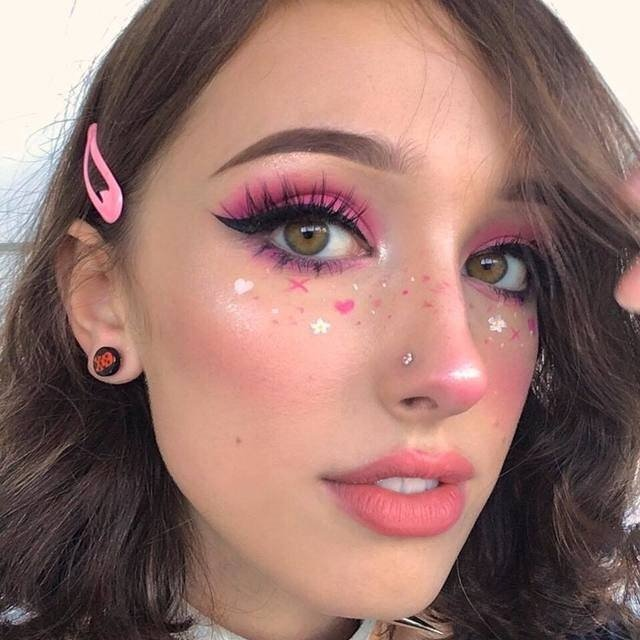 girl with makeup in fuchsia pink and outlined freckles in hearts