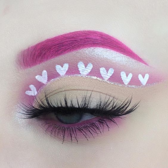 girl with clear eyeshadow outlined in hearts