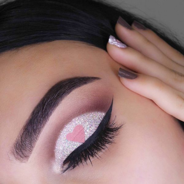 silver eyeshadow with cateye liner and a heart in the center