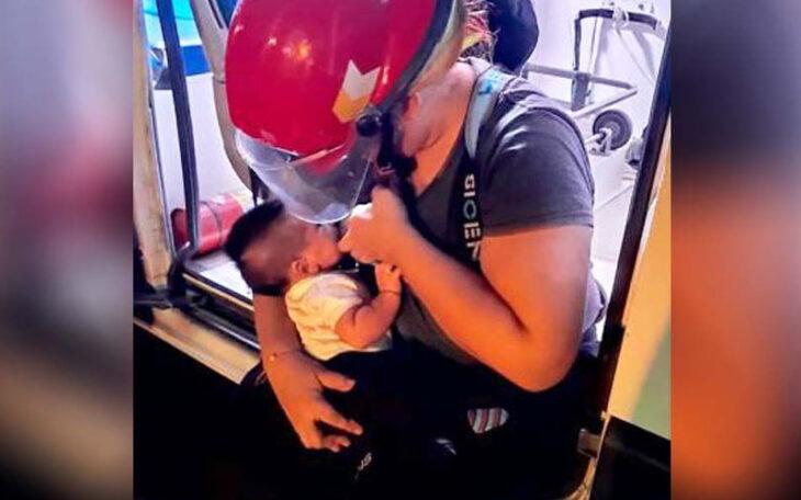 Bombero María amamantando a su bebé Benjamín durante un incendio