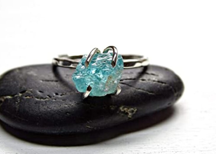 Silver color engagement ring with blue stone