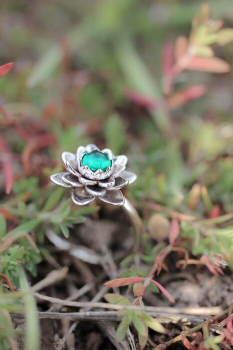 Silver color engagement ring with aqua green stone