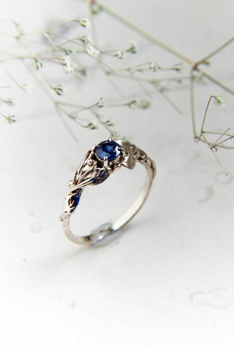 Silver color engagement ring with amrino blue stone