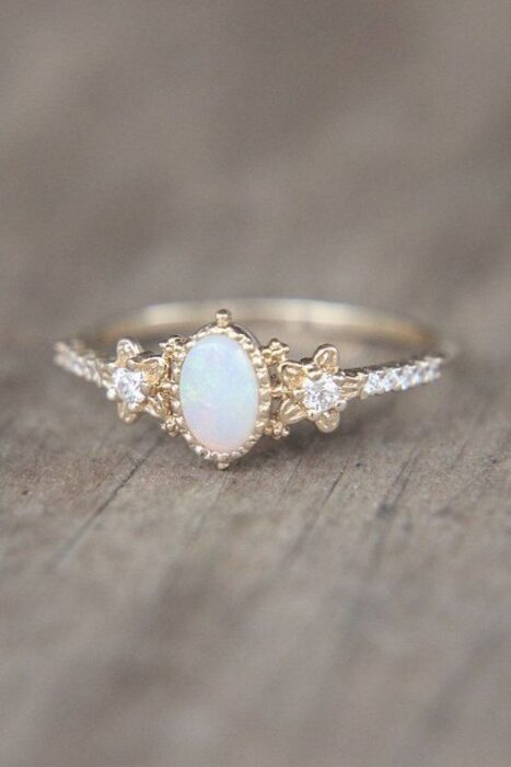 Silver color engagement ring with white stone