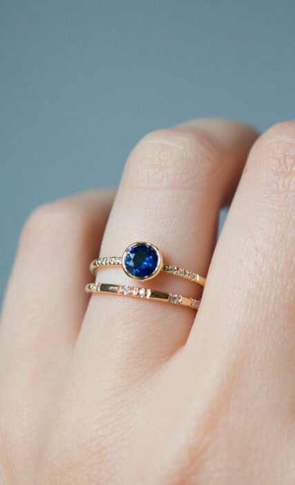 Gold color engagement ring with royal blue stone