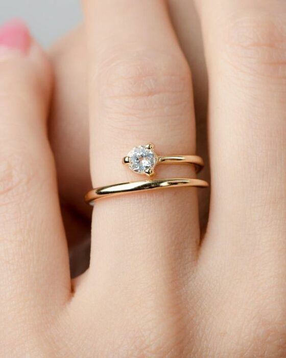 Gold color engagement ring with white stone
