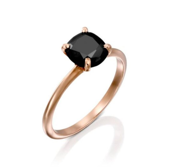 Gold color engagement ring with black stone