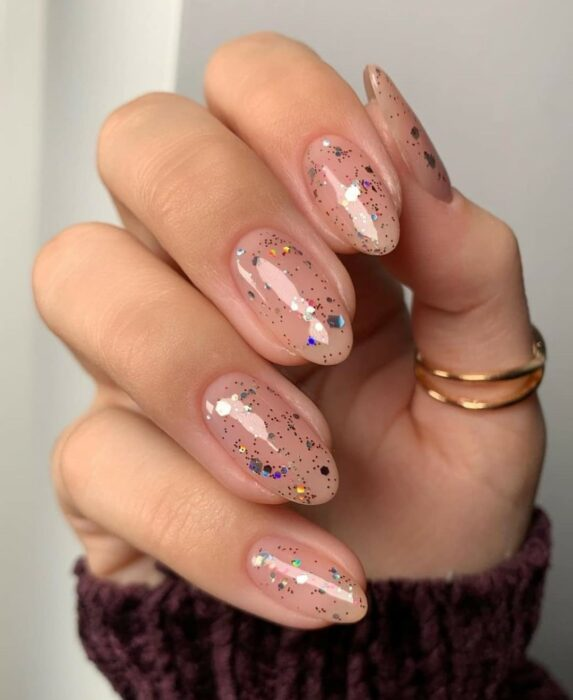 Short acrylic nails with clear glitter polish