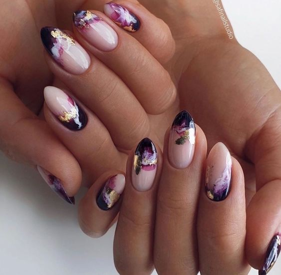Short almond shaped nails with gold and black colors