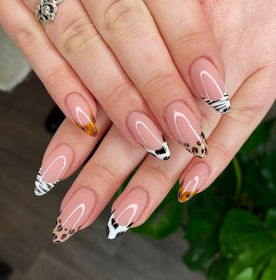 Almond-shaped acrylic nails with animal print tips