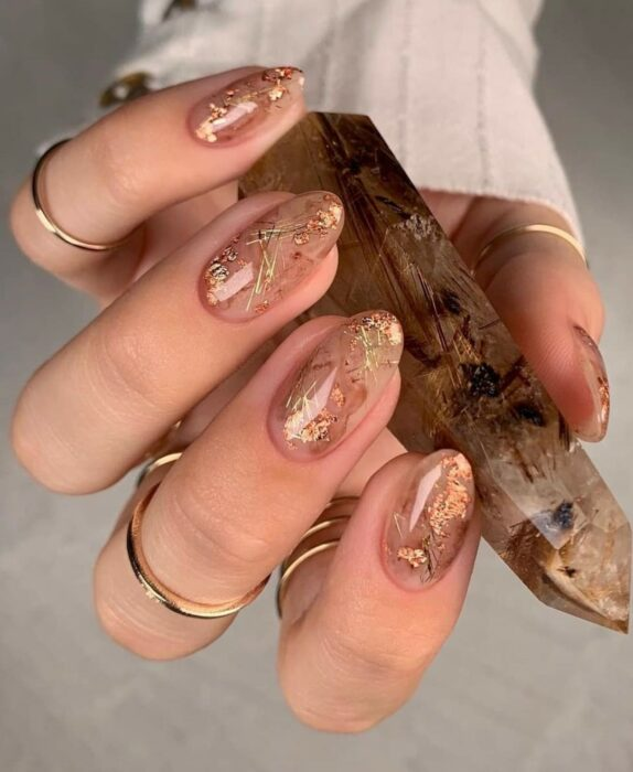 Short acrylic nails with gold decoration