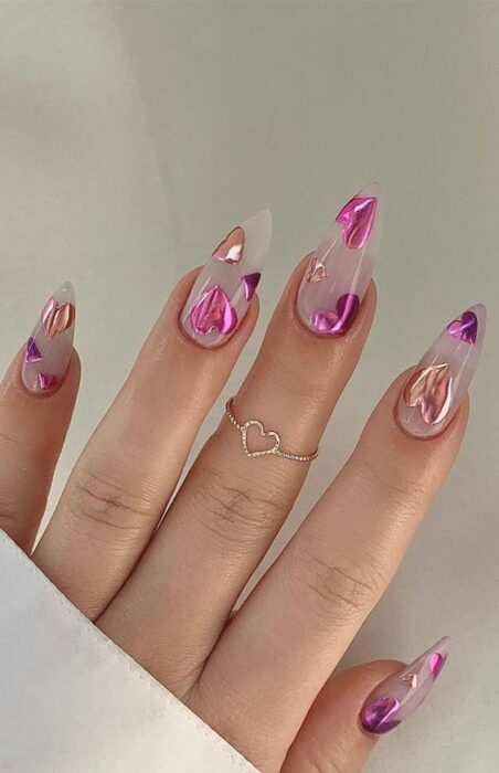 Transparent nails with pink sparkly hearts