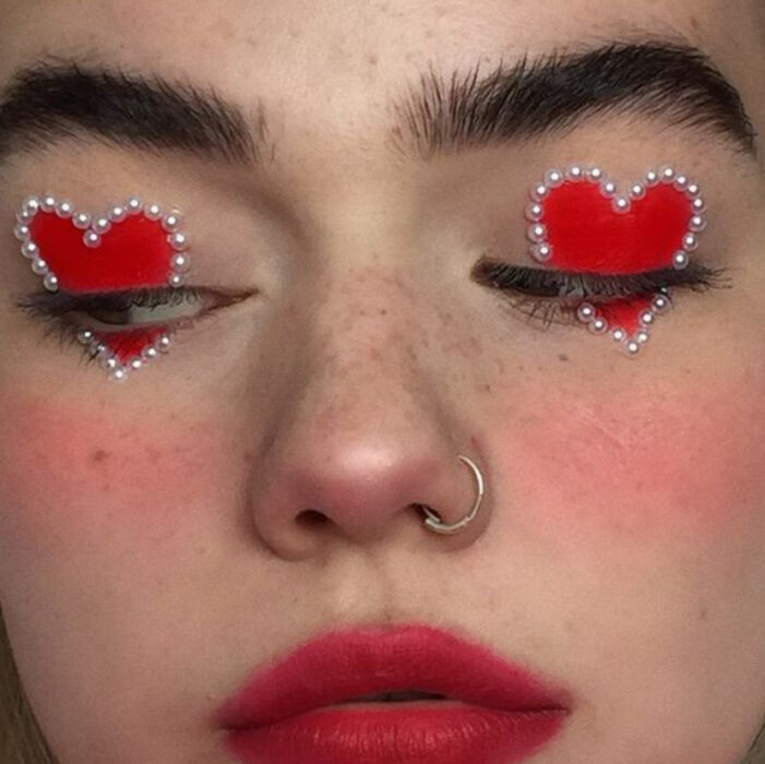 Valentine-inspired makeup in red colors with pearl applications